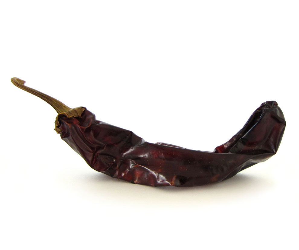 Guajillo - zdroj: http://upload.wikimedia.org/wikipedia/commons/6/6c/Capsicum_annuum_%28Guajillo%29_-_dried.jpg